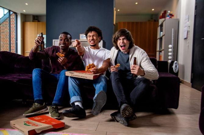 Men celebrating with pizza